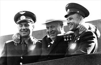 Moscow august 9, 1961, the rally of the moscow working people on the red squar , n s khruschev with heroes - cosmonauts, g s titov and y a gagarin on the lenin's tomb.