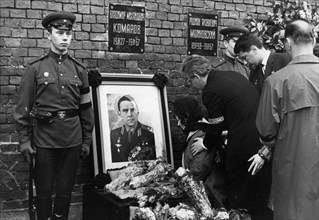 Funeral for vladimir komarov who perished during the soyuz-1 mission, his widow valentina yakovlevna and cosmonauts k,p, feoktisov and b,b, yegorov at the kremlin wall where his ashes were intered, ap...