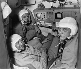 The crew of the soyuz 11 mission (l to r) test engineer viktor patsayev, commander georgi dobrovolsky, and flight engineer vladislav volkov in the cabin of the spacecraft, june 1971.