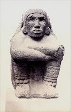Stone seated figure of Xochipilli, British Museum