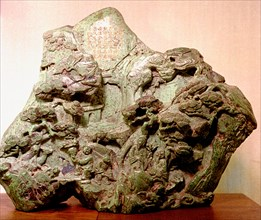 Jade carving depicting a Taoist mythological scene with figures on a mountain path ascending towards pavilions