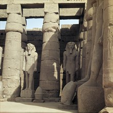 The First Courtyard with statues of Ramesses II, situated in front of the triple barque shrine dedicated to the gods Amun, Mut and Khons