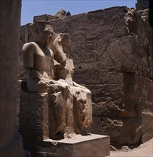 The seated double statues of the gods Amun and Mut, from the processional colonnade of Amenophis III