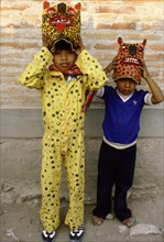 Two boys dressed as jaguars, in a fertility and rain making festival dating from the pre-Columbian times