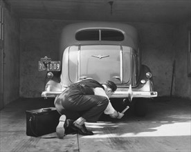 Man Working On HIs Car