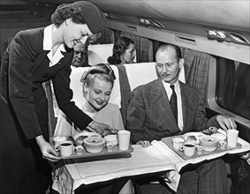 A Stewardess Serving Breakfast