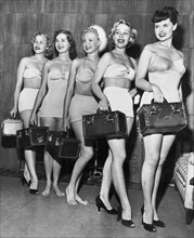 Five Women Pose With Bags