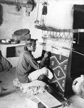 Navajo Man Weaving A Blanket