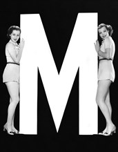 """The Letter """"M""""  And Two Women"""