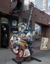 Guitar sign on in front of Legends Corner Bar on Broad Street in Nashville, Tennessee 2006