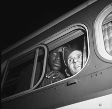 Washington, D.C. Soldiers looking out the window of the bus just before leaving the Greyhound terminal 1943