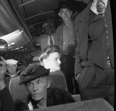 A Greyhound bus trip from Louisville, Kentucky, to Memphis, Tennessee, and the terminals. Passengers standing in aisles on Memphis-Chattanooga Greyhound bus 1943