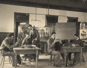 African American Students Study Telephone Assembly at the Hampton Institute