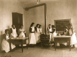 Breakfast lesson in home economics class for women. Carlisle Indian School, Pa. 1901