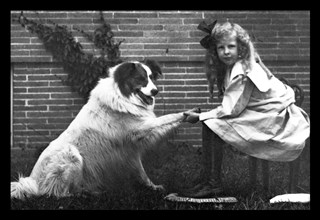 Girl Shaking Hands with Dog 1900