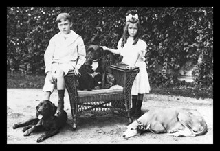 Boy and Girl with Their Four Dogs 1900