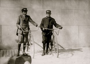 Two Messengers in DC on their bikes. 1912