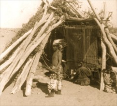 Navajo Blanket Weaving - an Indian Hogan (hut), on the Navajo Reservation, Arizona 1903