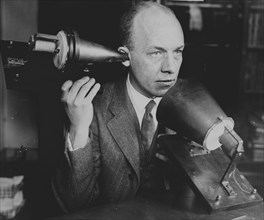 Man Hold's Bell's First Telephone 1920