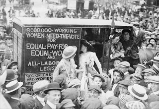 On the Top of a double Decker Bus, Washington Suffragettes make their Cause known