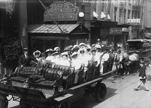 Women in Open Carriage Outside of Fancy Hotel & Restaurant