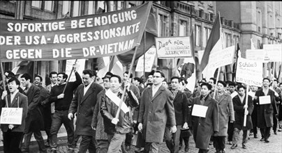The foreign students at the dresden university protest against u,s, attacks in vietnam.