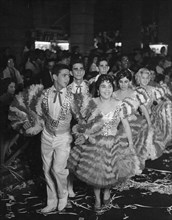 Young men and women dancing the comparsa, one of the most popular folk dances in cuba, during carnival, a traditional national festival, 1962.