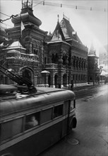 Moscow, late 1930s, a trolley-bus going past the french embassy building.