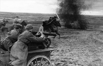 A machine-gun carriage supporting a red army cavalry charge, may 1944.