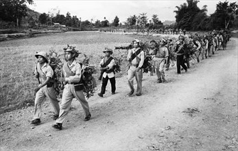Troops of the south vietnam liberation army marching towards the front along the ho chi minh trail, vietnam war, september 1966.