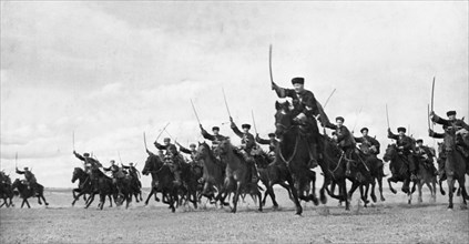 A cossack cavalry unit charging with sabres drawn on the crimean front, may 1942.