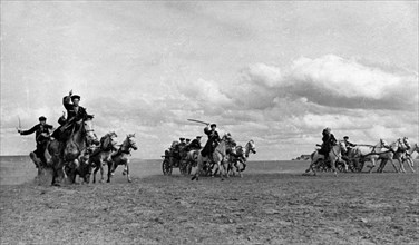 Cossack machine-gun carriages advancing to the firing lines during world war ll, may 1942.