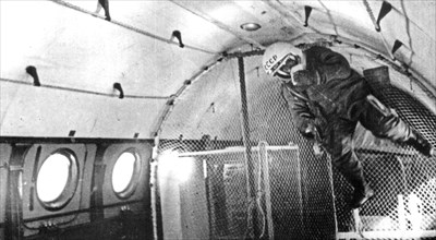 A soviet cosmonaut undergoing training for weightlessness in an airplane, 1960s.