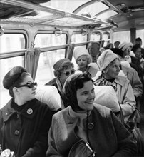 A group of american tourists on a bus on their way to the resorts 'friendship' and 'golden beach' in bulgaria, late 1950s.
