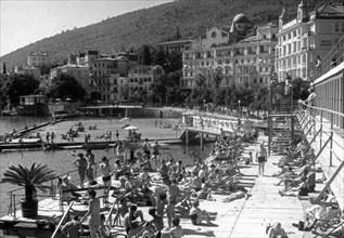 Popular beach of opatija on the adriatic coast, yugoslavia, mid 1960s.