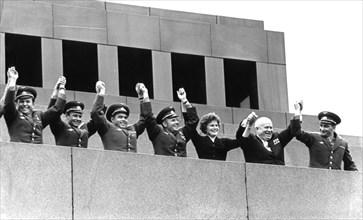 Soviet cosmonauts (left to right) dozovich, titov, andreyevich, gagarin, tereshkova, and bykovsky on lenin's tomb with nikita khrushchev, moscow, ussr, 1963.