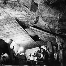 An auto repair shop in a cave near thank hao along the ho chi minh trail, vietnam war, 1968.