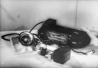 A photo electric device and multiplier controlling the use of batteries used in sputnik 2, the larger device is the other radio transmitter, while the satellite was in the shadow of the earth, electri...