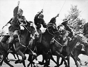 Red army cavalry charge with sabers drawn, following the tanks into the action, world war ll.