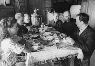 A family at breakfast on the 'pobeda' collective farm, august 1948.