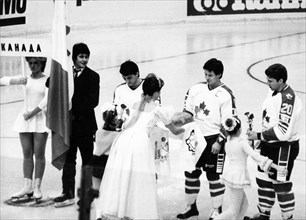 Traditional 'bread and salt' of hospitality being presented to the canadian ice hockey team during the opening ceremonies of the izvestia prize international ice hockey tournament on december 16, 1986...