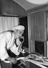Dima kiryanov taking breakfast orders aboard a tu-104 airliner during a trans-siberian flight, july 1956.