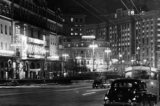 Movie theaters on 'theater thoroughfare' at night in moscow, ussr, december 1958.