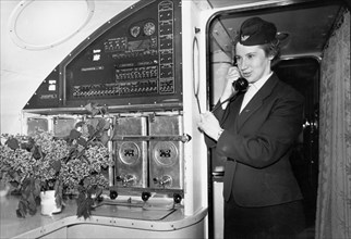 A stewardess taking dinner orders aboard a tu-114 airliner (at the time, the world's largest), may 1959.