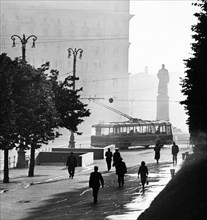 An early morning street scene at dzerzhinsky square in moscow, august 1959, kgb headquarters, lubyanka, is in the background.