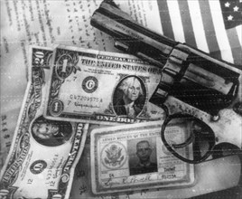 Vietnam war, pistol, money, and identification documents of u,s,a,f, lieutenant lynn k, powell whose plane was shot down by vietnamese anti-aircraft gunners during a raid on hanoi on august 21, 1967, ...