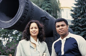 American boxer, muhammad ali, with his wife veronica standing by the tsar cannon in the kremlin during their visit to the soviet union in 1978.