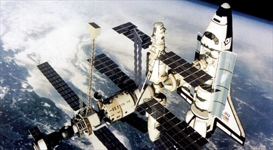 On the 29th of june 1995 the spaceship 'atlantis' (usa) docked with the space station 'mir' for a joint space flight lasting five days, nasa photo.