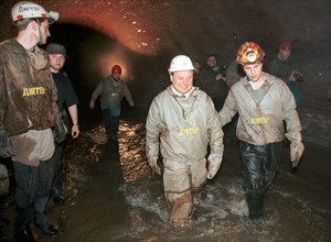 Vadim mikhailov, leader of the organization diggers of planet underground, (right) with yegor gaidar during a demonstration descent to the underground river neglinka under theater square in moscow, ru...