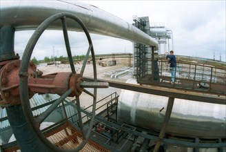 Tyumen area, 1995, clearing and preparation of oil for submission in pipelines on the firstpump station of the sugmut deposit, the sugmut deposit located among bogs between of nadym and purya, is one...